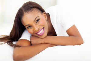 beautiful african american woman lying on bed